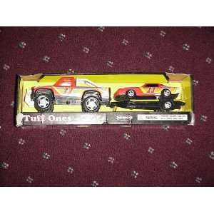 Toy truck with trailer and car