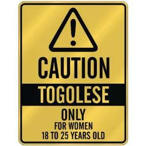 CAUTION  TOGOLESE ONLY FOR WOMEN 18 TO 25 YEARS OLD  PARKING SIGN